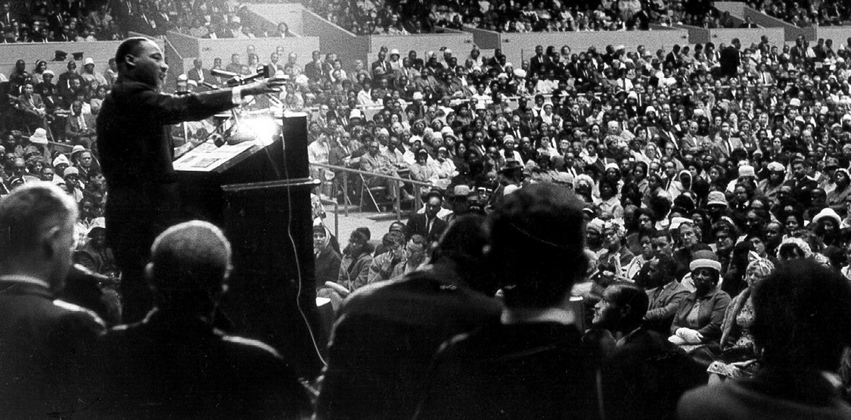 martin luther king, jr. making a speech at a podium