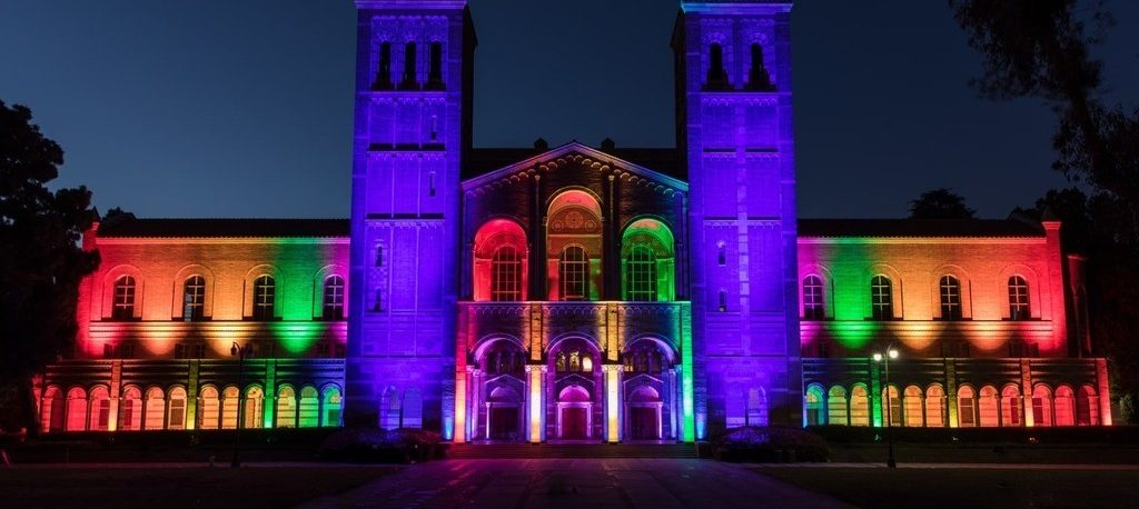 royce hall lit up in lgbtqia+ rainbow colors