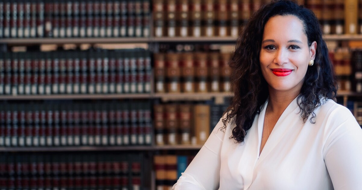 anna spain bradley surrounded by legal books